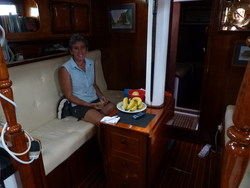 The saloon is the name for a sitting room or lounge on a boat, at anchor it is very comfortable but at sea everything has to be stowed away to stop it falling off the table when the boats rocks or heels over